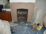 Fit lintel and render/plaster and lay slate hearth prior to stove installation